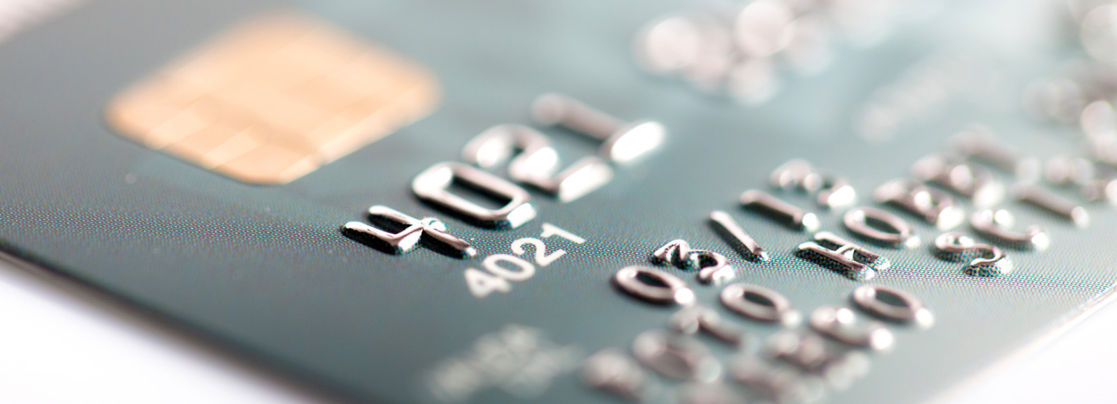 Close up of credit card on a white background